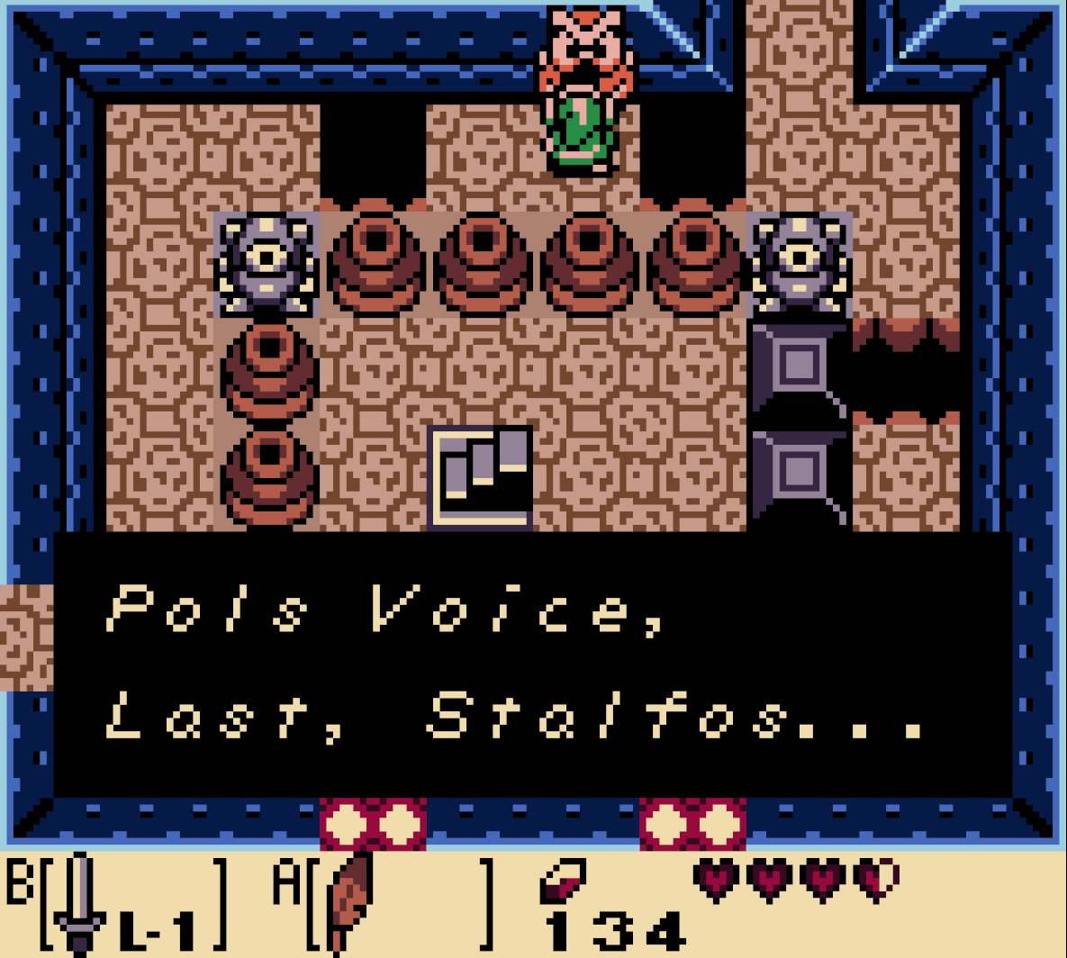"Owl statue in Link's Awakening DX on the Game boy, saying ""Pols Voice, Last Stalfos"""